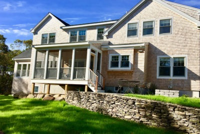 New home on Cape Cod with stone wall